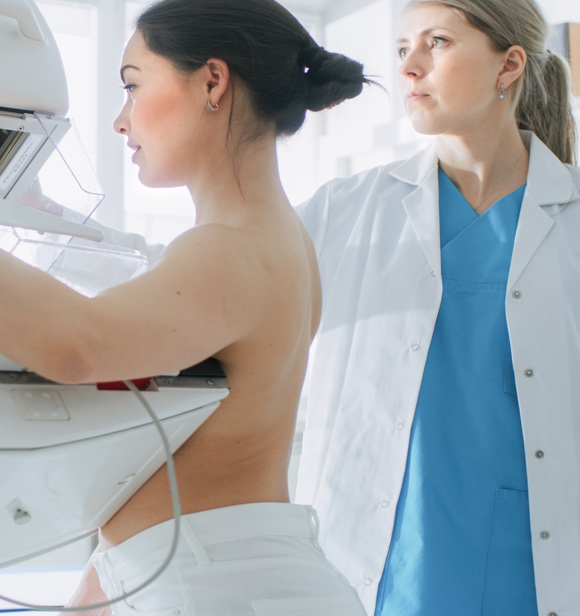 A woman having a breast scan.